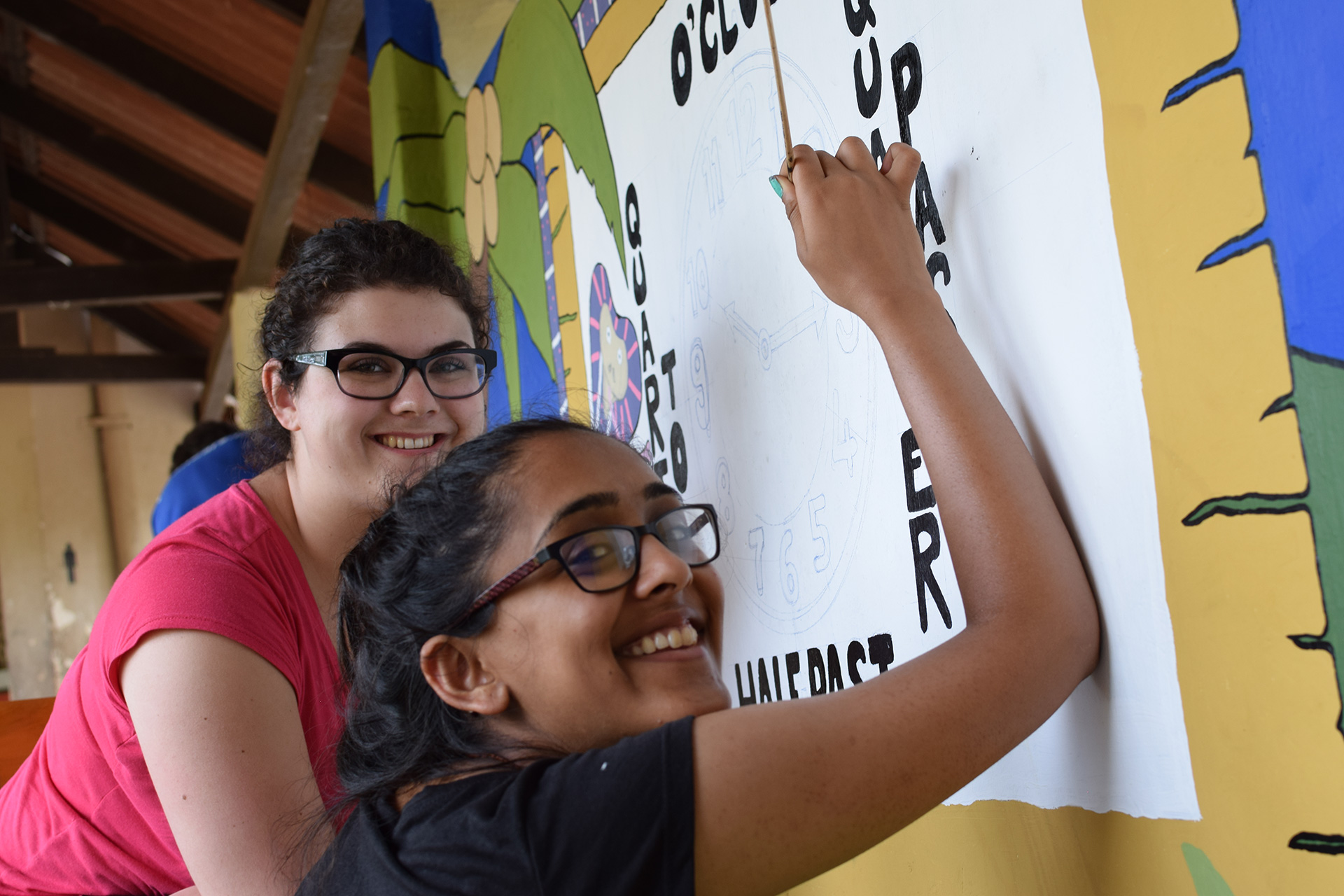 Painting a mural at one of our partner Deaf schools on a 2 week group trip with VoluntEars