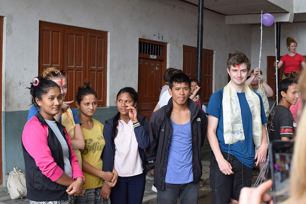 George doing activities with local students during the Mary Hare School Nepal trip with VoluntEars