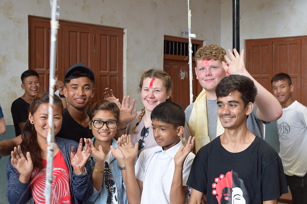 Ollie doing activities with local students during the Mary Hare School Nepal trip with VoluntEars