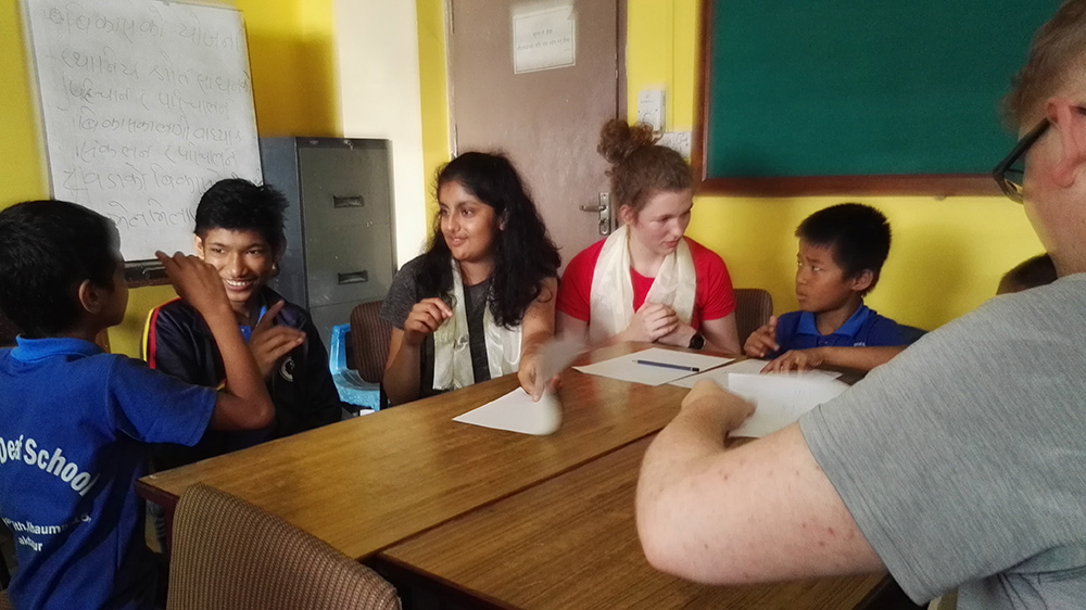 Vidhu teaching in a Deaf school in Kathmandu during her Nepal trip with VoluntEars