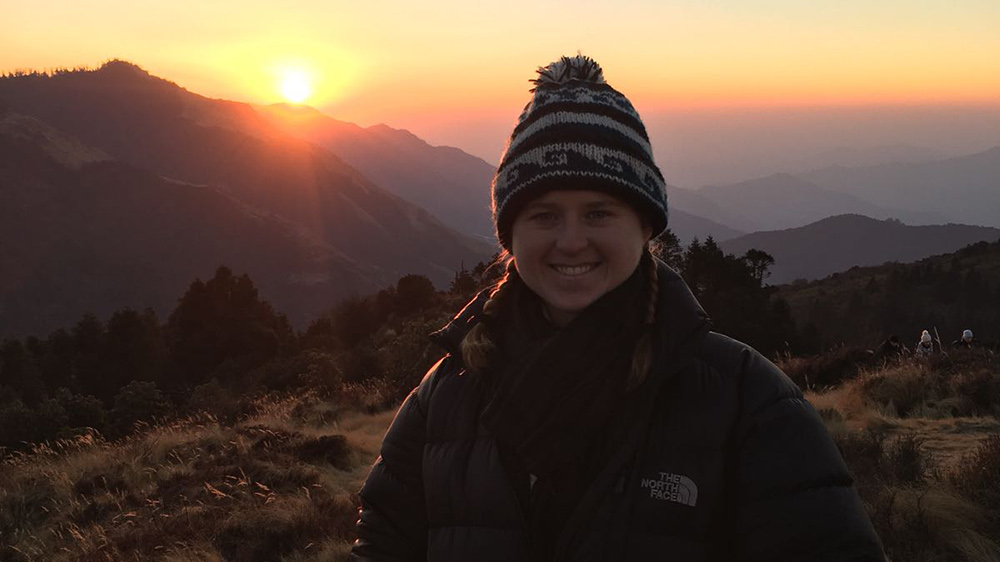Alanna watching the sunrise in the Himalayan mountains during her Nepal trip with VoluntEars