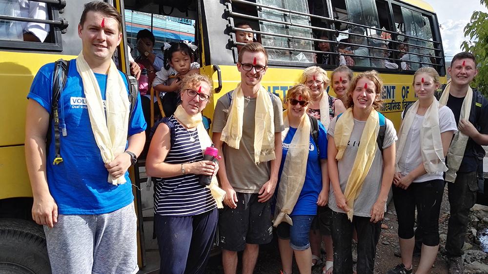 Volunteers arriving at school in Nepal on the Deaf school bus