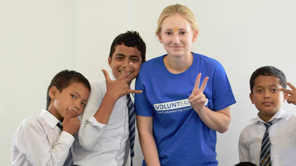 Athena with some of the local students during her Nepal trip with VoluntEars