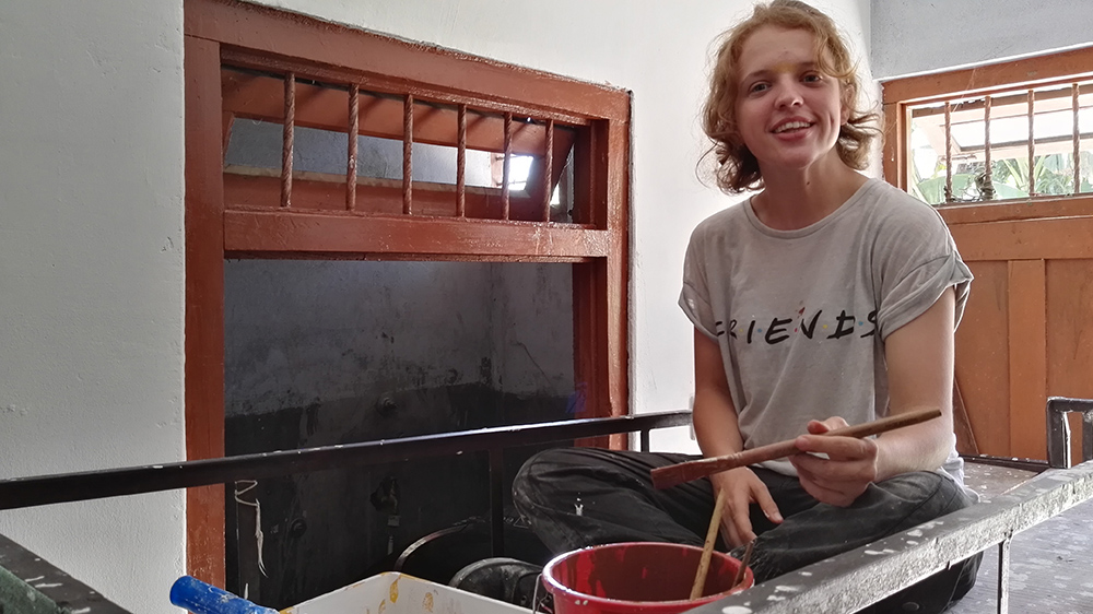 Katie helping to paint a Deaf school dormitory during her Nepal trip with VoluntEars
