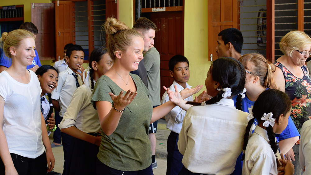 Libby doing activities with local students during her Nepal trip with VoluntEars
