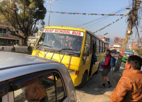 Taking the bus to school every morning near Pokhara