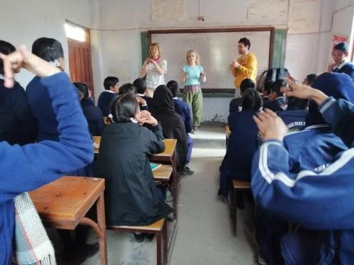 Sally and other volunteers take a class during the VoluntEars trip to Nepal