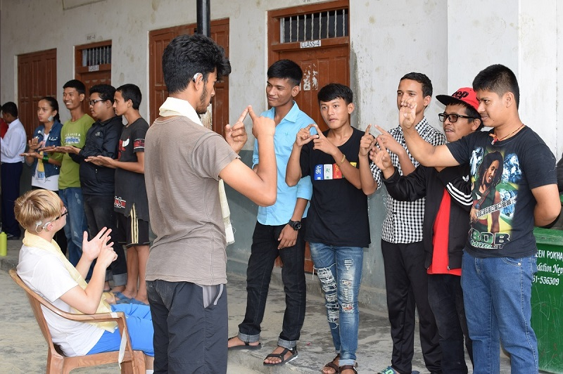 Volunteers doing activities with local deaf students in Nepal