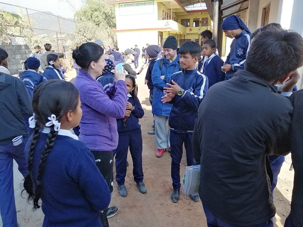 Delyth signing with students at a Deaf school in Nepal, on her trip with VoluntEars