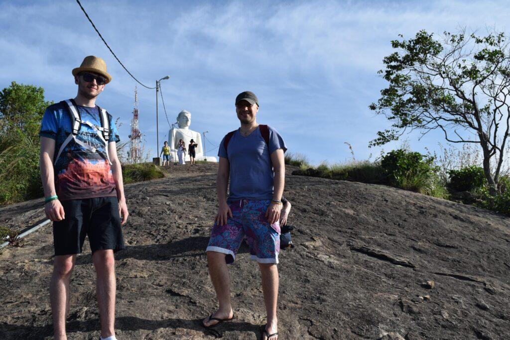 Keegan Hall-Browne visiting a Buddhist statue in Sri Lanka