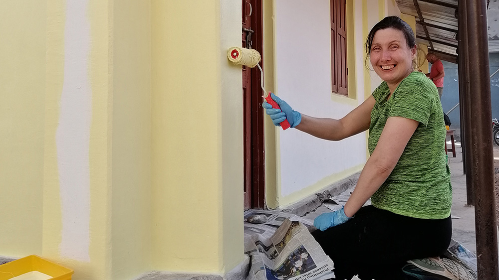 Delyth helping to paint the Deaf school library during her trip with VoluntEars
