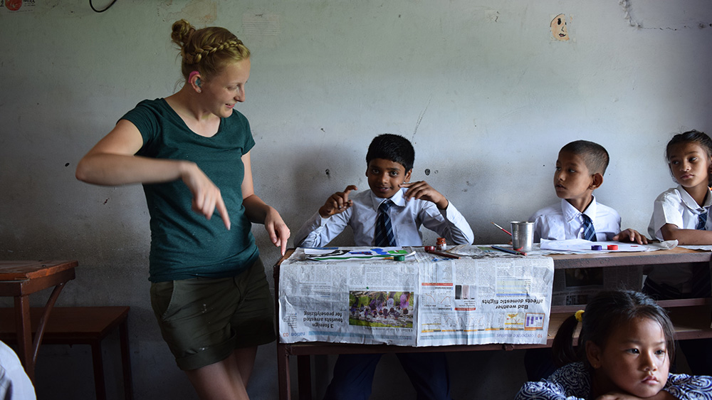 Ellie teaching at a Deaf school during her Nepal trip with VoluntEars