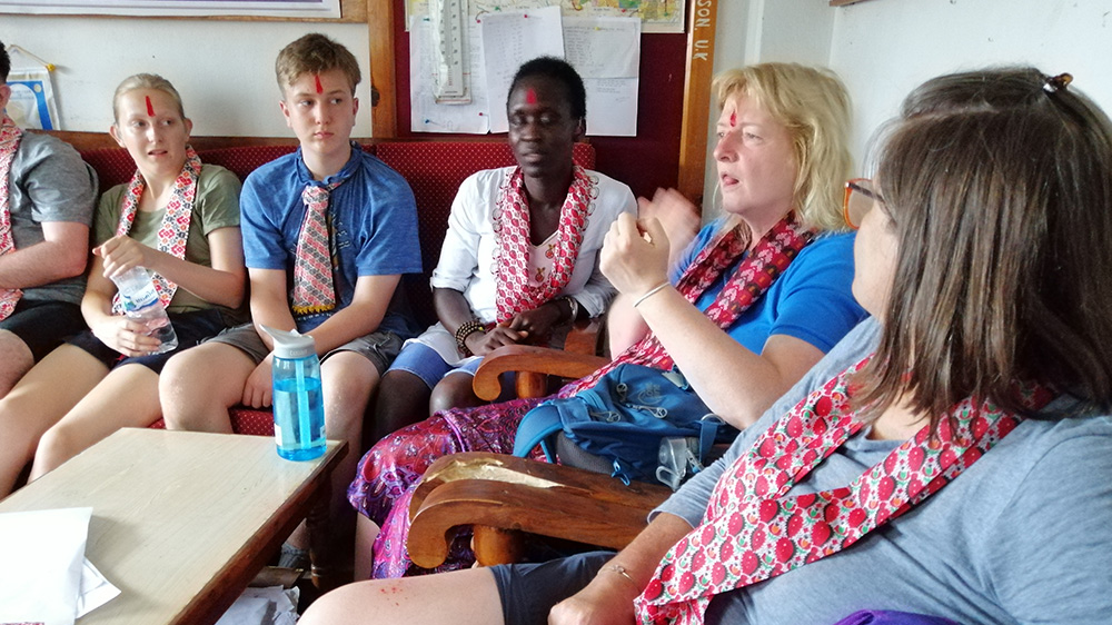 Janet discussing Deaf education with the volunteers and school Principal during her Nepal trip with VoluntEars