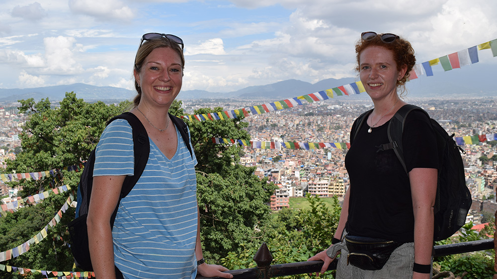 Kathryn (left) looking at the view of Kathmandu during her Nepal trip with VoluntEars