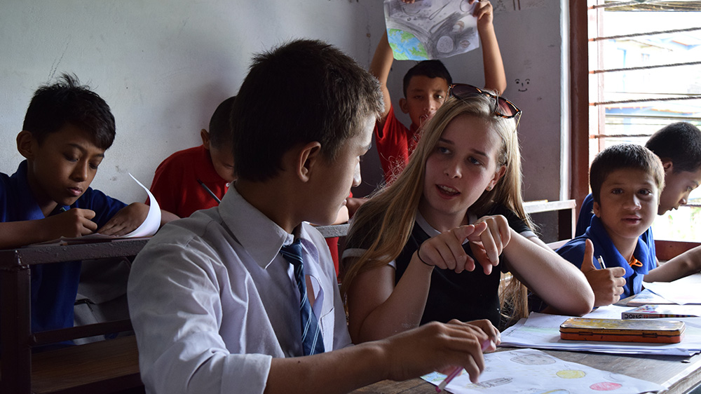 Leah helping in class during her Nepal trip with VoluntEars