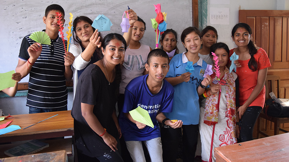 Minara helping in an art class at a Deaf school in Nepal