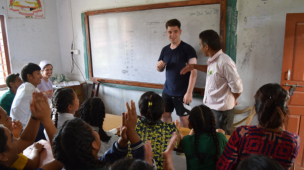 Dylan helping in a class at a Deaf school during his Nepal trip with VoluntEars