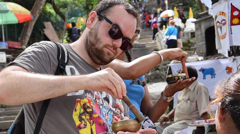 "James using a ""Singing bowl"" during his Nepal trip with VoluntEars"