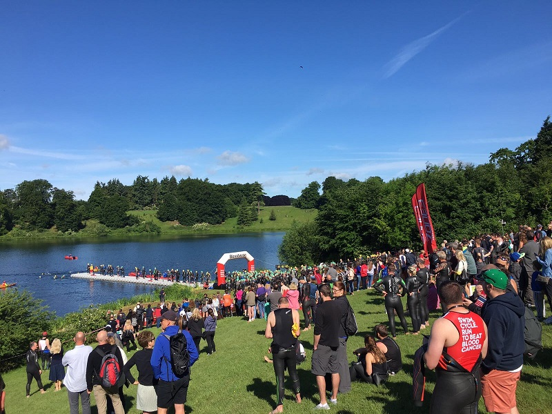 People watching swimmers start the Blenheim Palace Triathlon